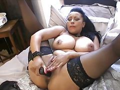 Horny British milf takes toy to cunt in bed tubes