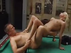 Heavily tattooed blonde fucked on pool table tubes