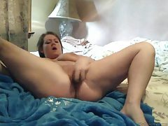 Chubby amateur pounds pussy with a toy tubes