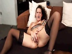 Slut in stockings masturbates with legs open tubes