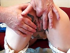 Tattooed girl gets a pussy massage tubes
