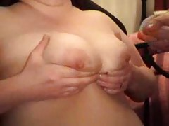 He plays with her nipples and masturbates tubes