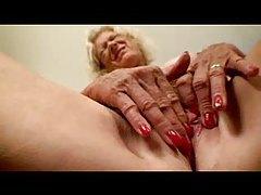 Gorgeous granny masturbates her hole tubes