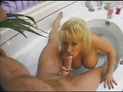 Hammering a huge tit blonde in the bath tubes