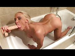 Hot blonde in the shower using a dildo tubes