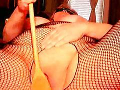 Fat chick wearing fetish gear and playing tubes