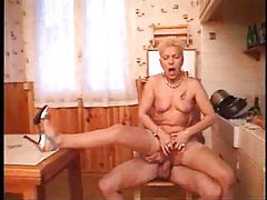 He anally screws the mature slut in her kitchen tubes