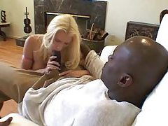 Pretty blonde with big tits takes huge black dick tube