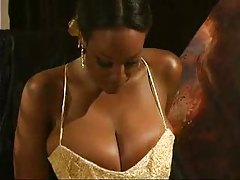Black girl in ball gown plays with big tits tubes