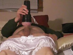 Man in satin panties uses a Fleshlight tubes
