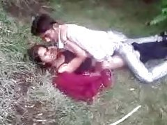 Indian couple fools around in the grass tubes