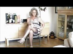 Granny models her sexy stockings tubes