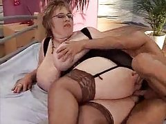 Mega tit BBW gets young man loving her tubes