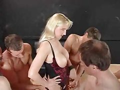 Four men fuck a pornstar and piss on her tubes