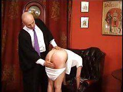 Schoolgirl spanked with various implements tubes