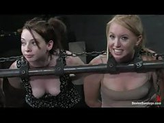 Three chained girls are lightly caned tubes