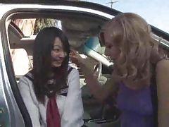 Cute Asian schoolgirl has interracial threesome outdoors tubes
