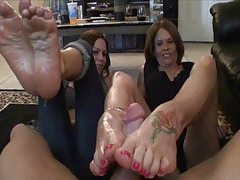 Two tremendous girls giving a footjob tubes