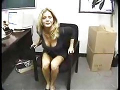 Amber Michaels gobbling cock in office tubes