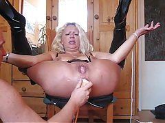 Anally toyed until her pussy squirts tubes