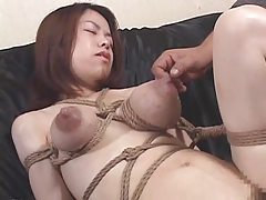 She oils up her big tits to show them off tubes