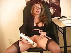 Corporate chick with big tits using toy tube