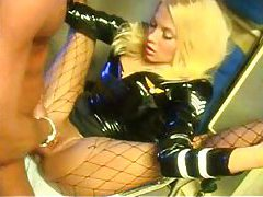 Amazing in a shiny dress sucking cock tubes