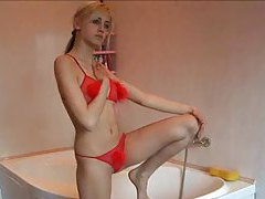 Blonde Russian chick posing in the shower tubes