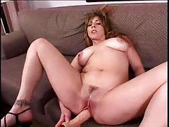 Dildo play and a nice blowjob from her tubes