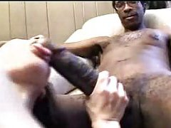 She orally works the monstrous black cock tube
