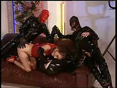 Girl in red latex takes a double penetration tubes
