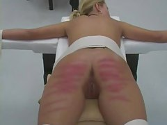 Young women are strapped to a table and caned tubes