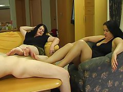 Two girls giving him a footjob tubes