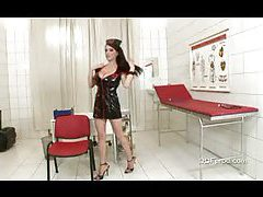 Nurse in latex dress showing big tits tubes