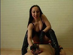 Dominatrix masturbates his cock in boots tubes