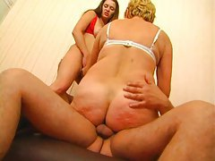 Threesome features a strapon and a hard cock tubes