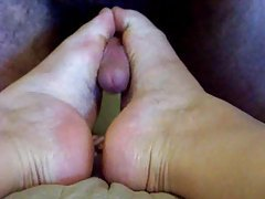 She holds her feet together and he fucks them tubes