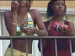 Black lesbians kissing on hotel balcony tubes