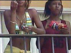 Black lesbians kissing on hotel balcony tubes