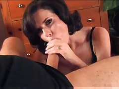 On her knees working meat with hands and mouth tubes