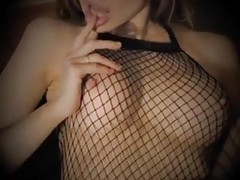 Girl in fishnet body stocking playing with tits tubes