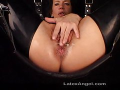 Chick in latex boots has her ass fisted tubes