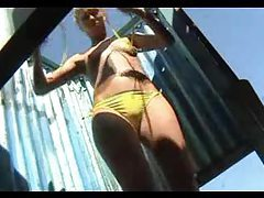 Hidden camera shows girls changing at beach tubes