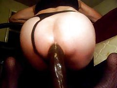 Sissy rides big black dildo with asshole tubes