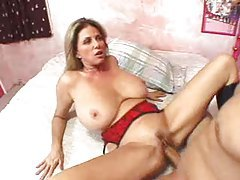Milf in boots has huge tits and loves cock tubes