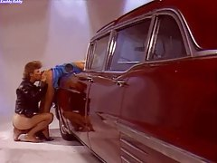 Classic scene with slut bent over a car tubes