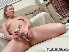 Masturbating with her electric toothbrush tubes