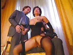 Brunette in black lingerie enjoys two cocks tubes