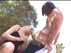Muscular guy licks and fingers her tubes
