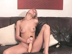 Blonde using a toy in front of her camera tubes